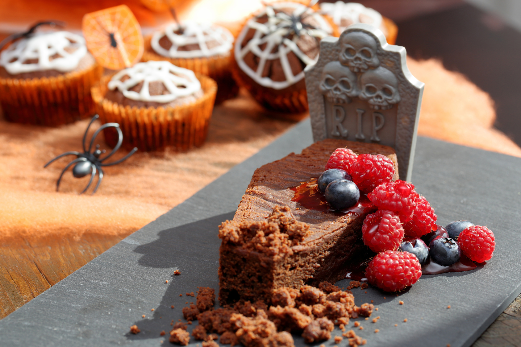 Chocolate cake with fruit in shaped coffin on Halloween day