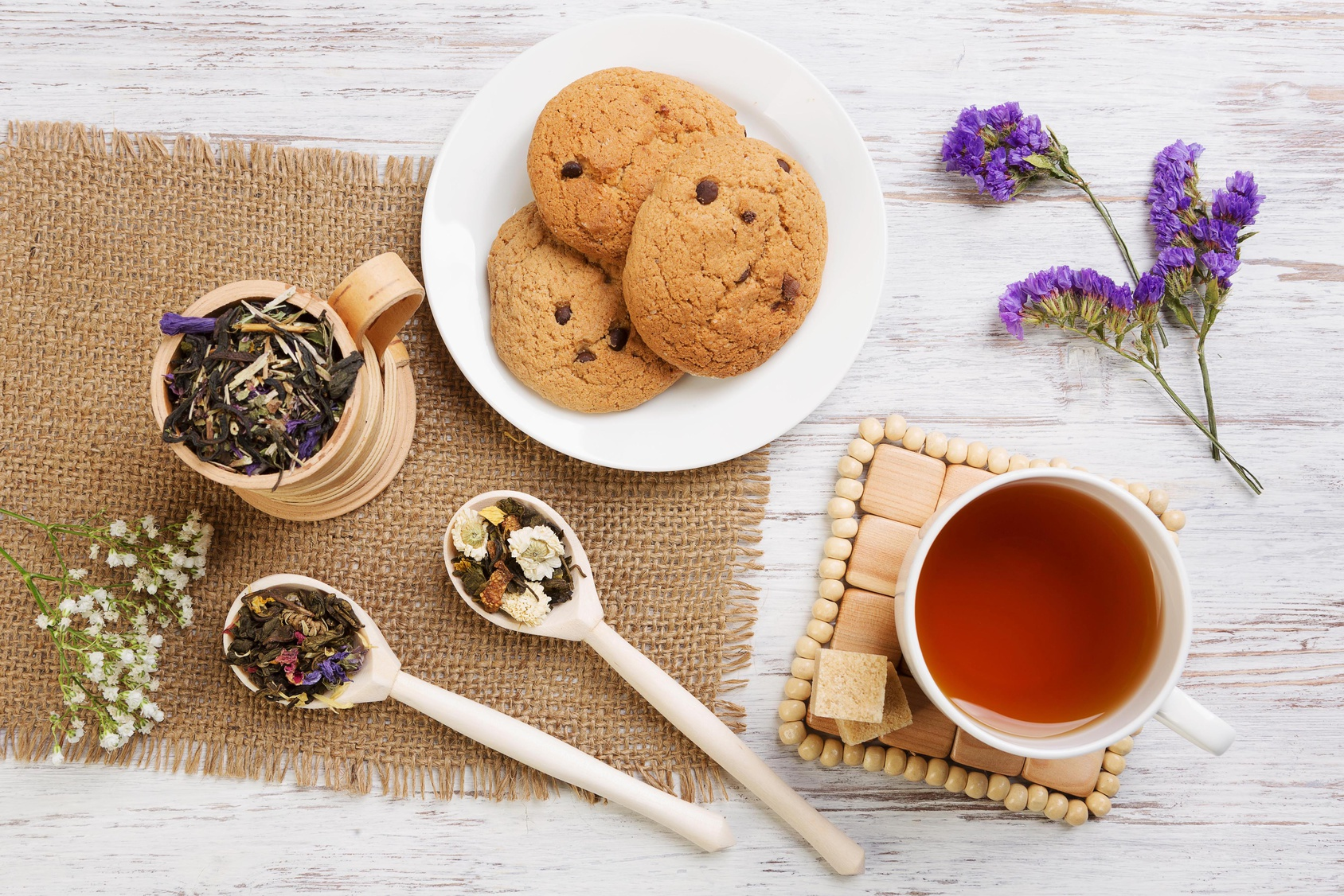 Various kinds of herbal tea on wooden table