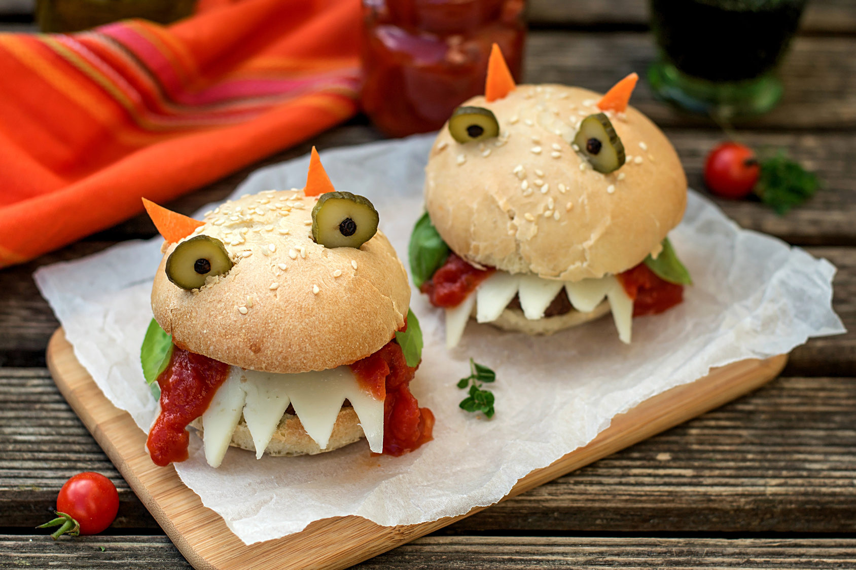 Burgers in the shape of devil with cheese, tomato sauce